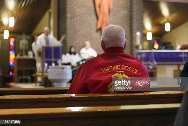 A veteran attends a Catholic mass for Hurricane Sandy victim David Maxwell at the St Charles Catholic Church on December 11 2012 in the Staten Island...