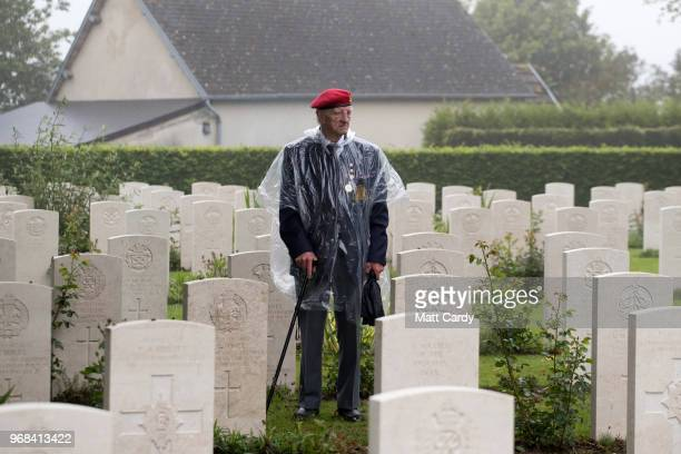 A veteran attends a service of remembrance at Bayeux Cemetery during DDay 74th anniversary commemorations in Normandy on June 6 2018 in Bayeux France...