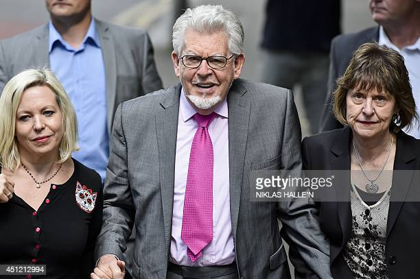 Veteran Australian artist and entertainer Rolf Harris arrives with daughter Bindi at Southwark Crown Court in central London on June 25 2014 Harris...