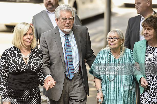 Veteran Australian artist and entertainer Rolf Harris arrives with his wife Alwen Hughes and daughter Bindi at Southwark Crown Court in central...