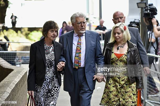 Veteran Australian artist and entertainer Rolf Harris leaves with his daughter Bindi after attending Southwark Crown Court in central London on June...