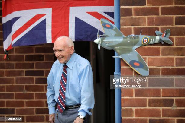 WWII veteran Bernard Morgan aged 96 comes out of his home to find neighbours have erected bunting and a cardboard cut out of a Spitfire before taking...