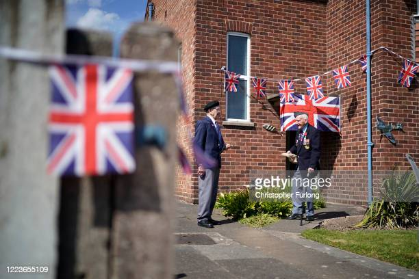 WWII veteran Bernard Morgan aged 96 is greeted by fellow veteran Tom Hassall aged 94 who made the short trip from a nearby village to greet Bernard...