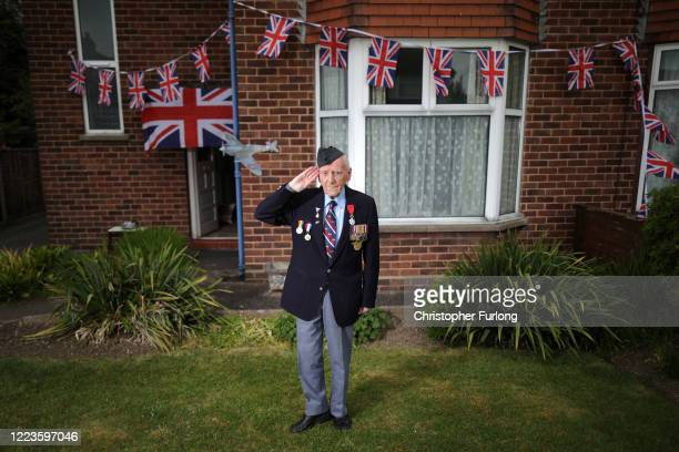 WWII veteran Bernard Morgan aged 96 poses as he takes part in the VE day two minute silence outside his home and alongside neighbours on the street...