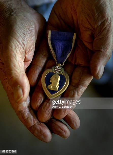WWII veteran Bernard Stelzer of Laguna Woods shown holding one of two purple hearts he was awarded was gunner of the Bim Bam Bola bomber that was...