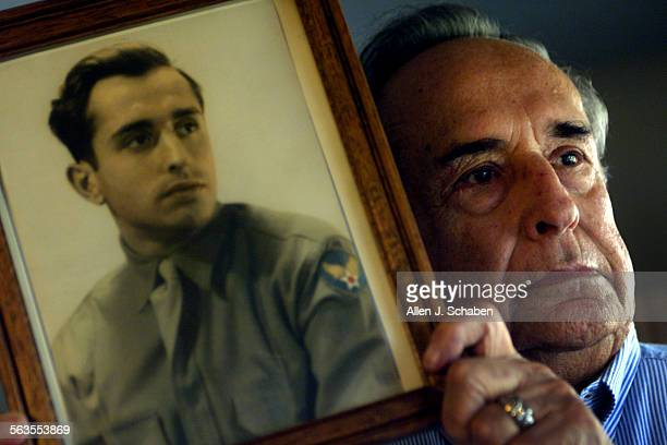 WWII veteran Bernard Stelzer of Laguna Woods shown with 1944 portrait of him wearing his Army Air Forces uniform was gunner of the Bim Bam Bola...