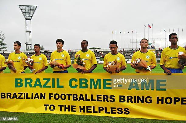 Veteran Brazilian footballers offer a minute of silence for victims of cyclone Nargis ahead of a charity match against veteran Myanmar footballers at...