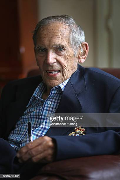 WWII veteran Brian Carter aged 90 poses at his home on August 5 2015 in Huntingdon England Brian served in the Royal Navy Volunteer Reserve during...