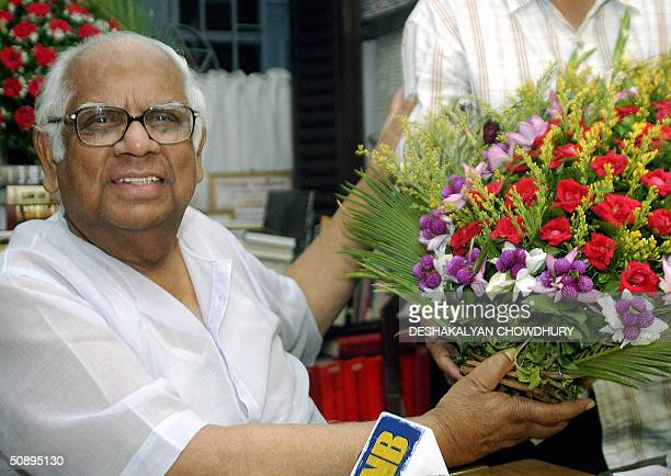 Veteran Communist Party of India leader Somnath Chaterjee poses with flowers sent by a supporter at his residence in Calcutta 25 May 2004 The CPIM...