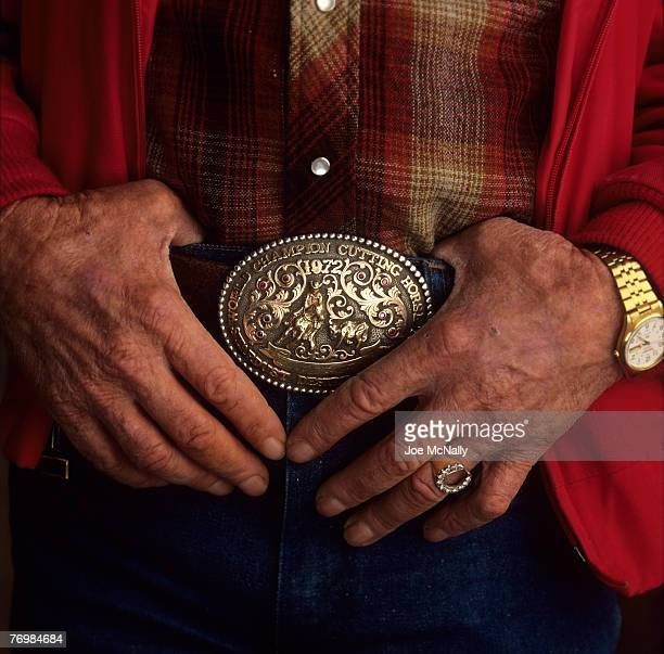 A veteran cowboy shows off some distinctively western jewelry in November of 1991 at a cutting horse competition in Fort Worth Texas The style of a...