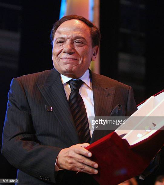 Veteran Egyptian comedian Adel Imam poses with his award for his achievements in 2008 during the closing ceremony of the 24th International Film...