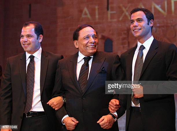Veteran Egyptian comedian Adel Imam poses with his children actor Mohammed and director Rami during the closing ceremony of the 24th International...