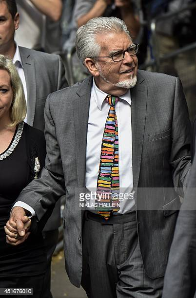 Veteran entertainer Rolf Harris smiles as he arrives at Southwark Crown Court in London on July 4 2014 Harris is expected to be sentenced later...