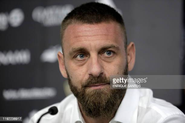 Veteran former Italy international Daniele De Rossi gestures during a press conference in Buenos Aires Argentina on December 6 where he announced his...