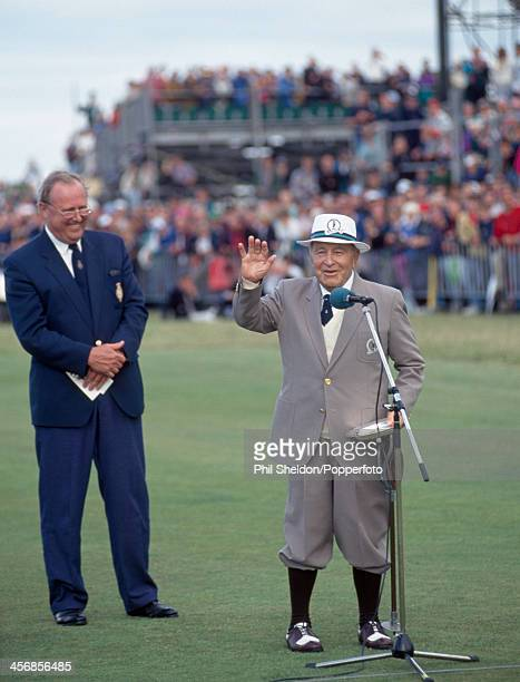 Veteran golfer Gene Sarazen of the United States talks to the crowd alongside Michael Bonallack chief executive of the Royal and Ancient Golf Club of...