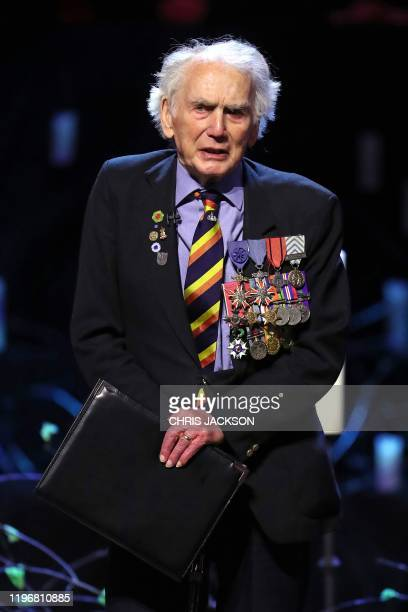Veteran Ian Forsyth speaks during the UK Holocaust Memorial Day Commemorative Ceremony at Methodist Central Hall in London on January 27, 2020. -...