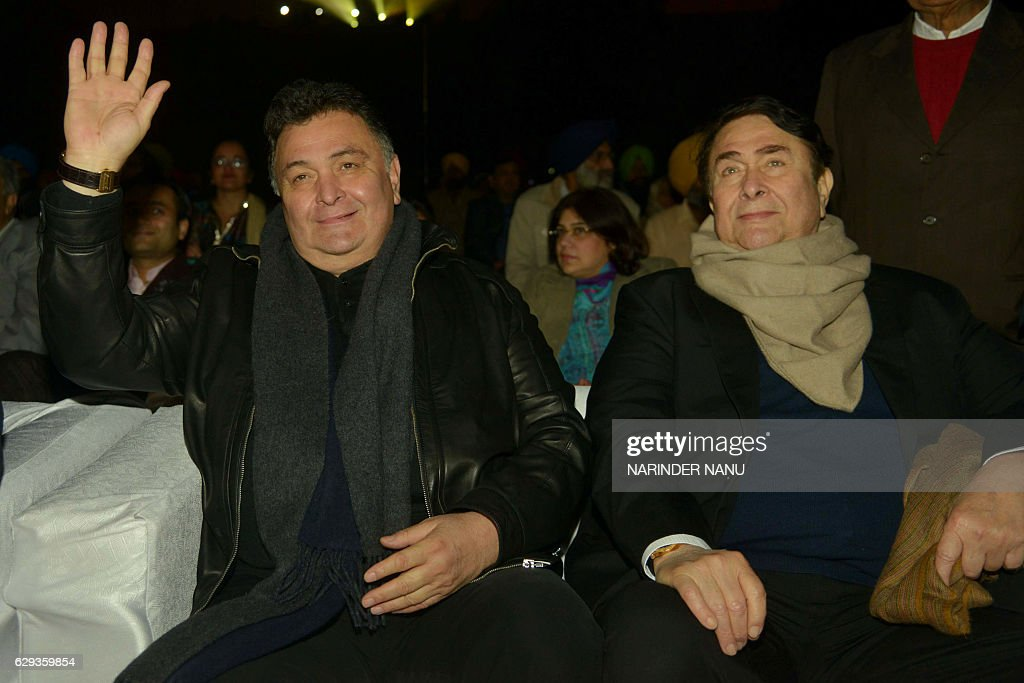 Veteran Indian Bollywood actors Rishi Kapoor and Randhir Kapoor (R) look on during an inauguration ceremony of the historic Gobindgarh fort in Amritsar on December 12,2016. The historic Gobindgarh fort marked the first phase of its renovations with an event attended by various celebrities of Indian cinema and other dignitaries. / AFP / NARINDER