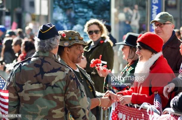 A veteran is seen shaking hands with with spectators during the annual Veterans Day Parade Thousands from more than 300 units in the Armed Forces...