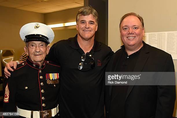 WWII Veteran Jack ten Napel Sean Hannity and Kirt Webster attend the Charlie Daniels 2015 Volunteer Jam at Bridgestone Arena on August 12 2015 in...
