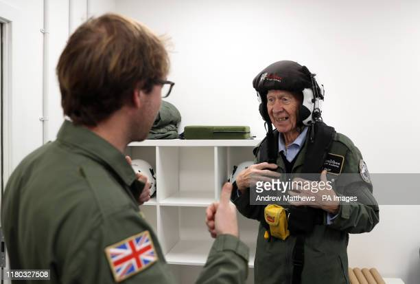 RAF veteran John Allinson is fitted with a helmet prior to a flight in a Spitfire at Solent Airport who has achieved the ambition of a lifetime by...