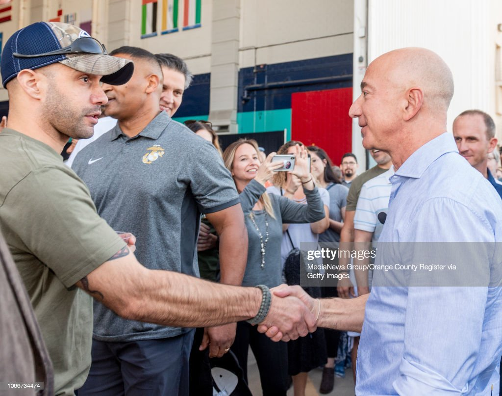 A Veteran Left Shakes The Hand Of Jeff Bezos Founder And Ceo Of