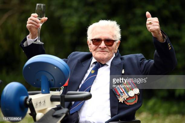 Veteran Len Gibbon celebrates after completing a 104mile staticbike cycling challenge to mark the 76th anniversary of the Normandy landings on June...