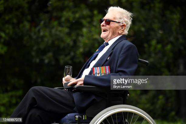 Veteran Len Gibbon relaxes with a glass of champagne after completing a 104mile staticbike cycling challenge to mark the 76th anniversary of the...