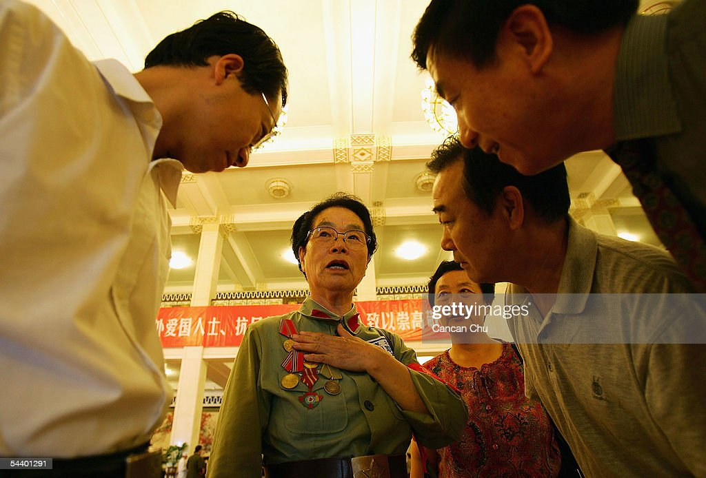 Veteran Li Min, 82, talks about her of experiences before a meeting marking the 60th anniversary of the victory of China's Resistance War Against Japanese Aggression on September 3, 2005 in Beijing, China.