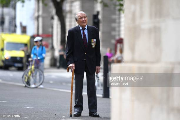 Veteran Lou Myers 93 looks up at the Cenotaph before taking part in a 2 minute silence to mark the 75th anniversary of VE Day the end of the Second...