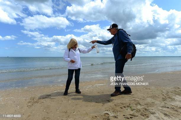 US veteran Michael Cassady and her wife Sharon collect shells at Utah Beach in SainteMarieduMont northwestern France on June 6 as part of DDay...