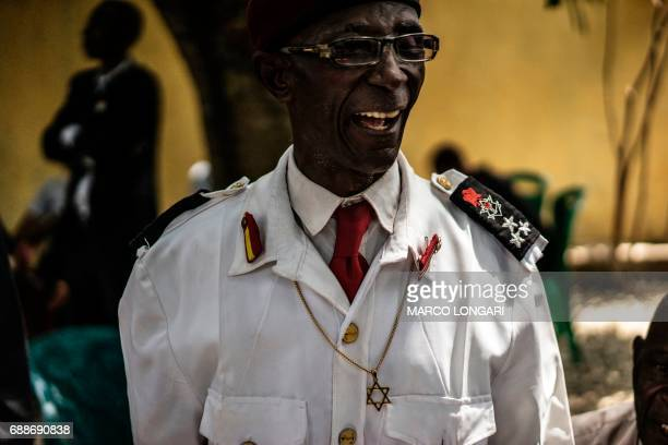 A veteran of the Nigerian civil war wearing the Star of David over his uniform reacts while being received by political activist and leader of the...