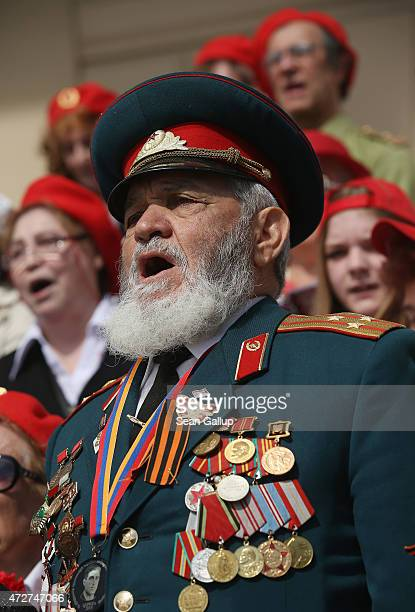 A veteran of the World War II Soviet Red Army joins a choir near the Bolshoi Theater to celebrate Victory Day as part of celebrations marking the...