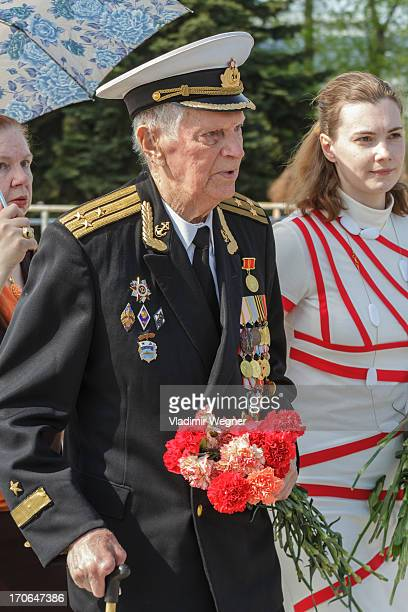 Veteran of World War II with his grand daughter during Victory Day celebration
