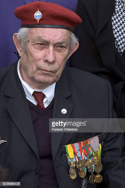 A veteran paratrooper attends the ceremony at Les Invalides to commemorate the 50th anniversary of the fall of Dien Bien Phu