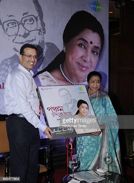 Veteran playback singer Asha Bhosle with Sanjiv Goenka chairman of Saregama India Ltd releasing her latest Bengali musical album Pancham Tumi Kothay...