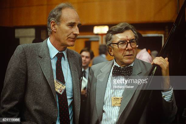 Veteran political BBC TV Broadcasters Peter Snow And Sir Robin Day listen to speeches during the 1989 Labour Conference in September 1989 in Brighton...