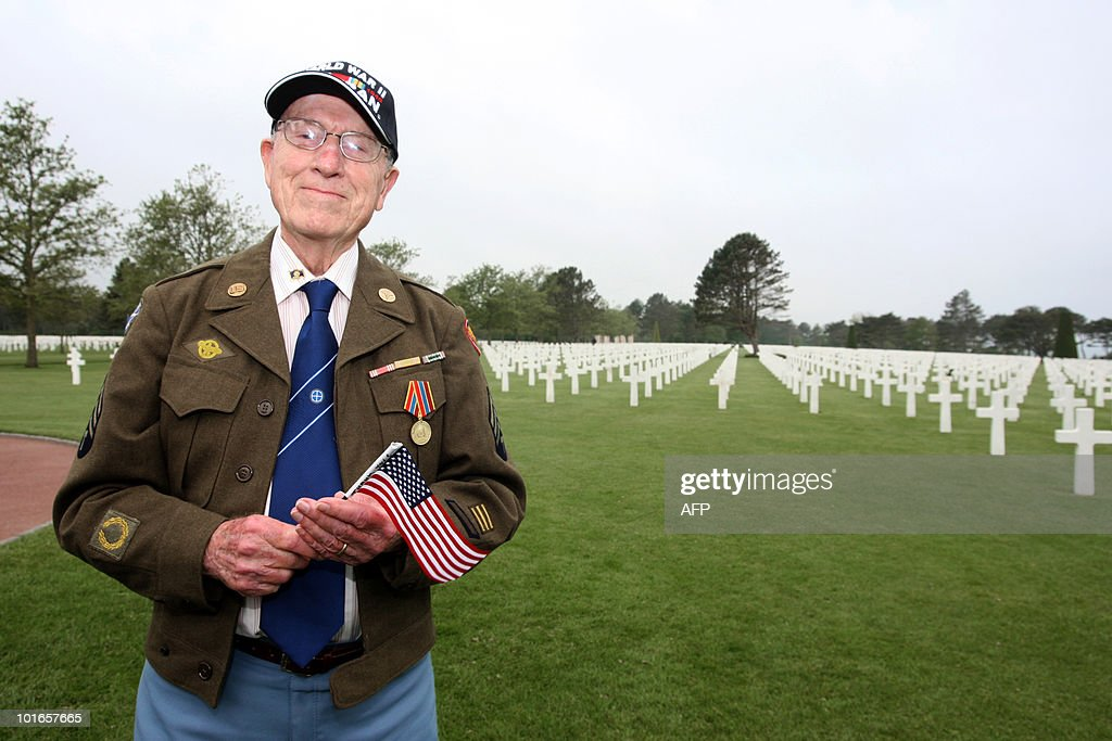 A US veteran poses at the American cemet