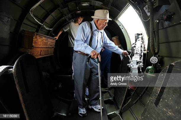 Veteran retired Air Force Capt Jim Force 89yearsold from Longmont Colorado looks over a gun in a bay of a B17G Flying Fortress at the Rocky Mountain...