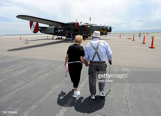 Veteran retired Air Force Capt Jim Force right 89yearsold from Longmont Colorado along with his wife Mary walk towards a B24J Liberator Aircraft at...
