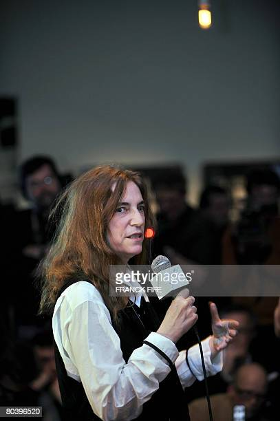 US veteran rocker Patti Smith speaks on March 27 2008 at the Fondation Cartier in Paris during a visit of the exhibition called 'Patti Smith land...