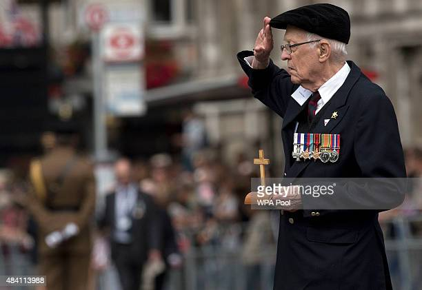 A veteran salutes as he takes part in a parade down Whitehall after a service of commemoration during the 70th Anniversary commemorations of VJ Day...