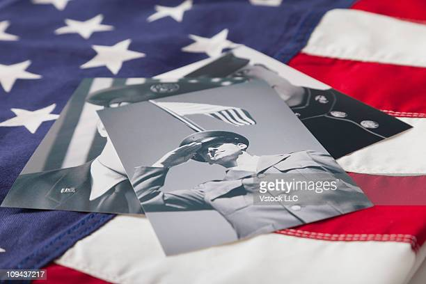 Veteran soldier photographs on Stars and Stripes flag