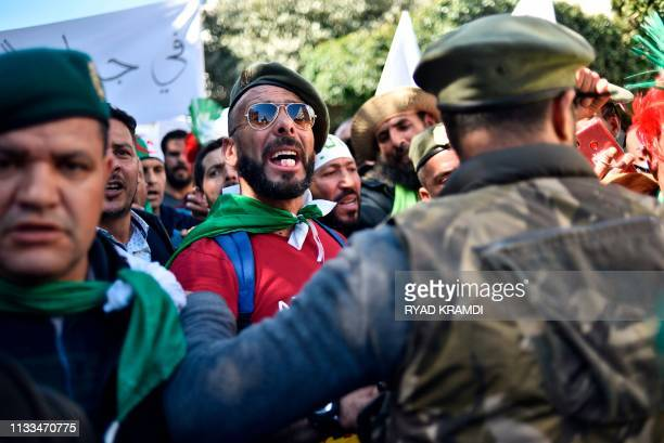 Veteran soldiers from Algeria's civil war take part in a demonstration against ailing President Abdelaziz Bouteflika in the capital Algiers on March...