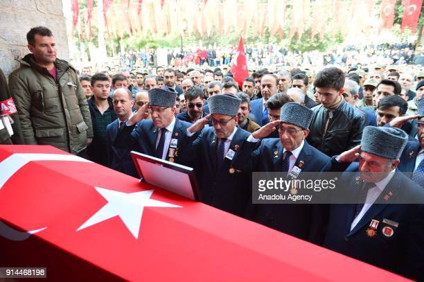 Veteran soldiers make a soldier salute around the coffin of martyred lieutenant Muhammed Cihangir Cubukcu who was martyred after the terrorist group...