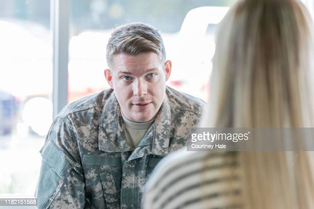 veteran speaking with counselor - post traumatic stress disorder stock pictures, royalty-free photos & images