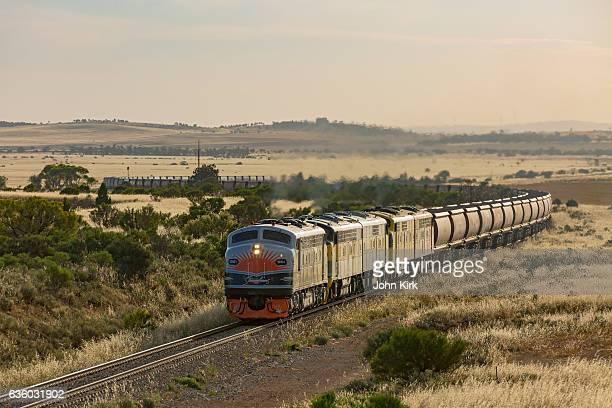 Veteran Streamliner locomotives work empty coal car drag