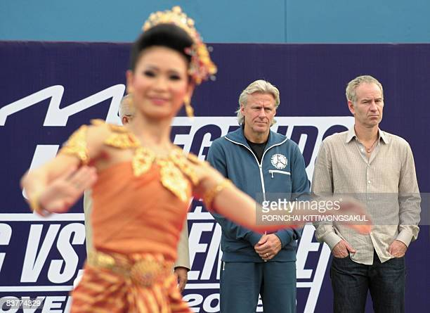 Veteran Swedish tennis player Bjorn Borg and John McEnroe of US watch a performers dancing during a press conference in Bangkok on November 21 2008...