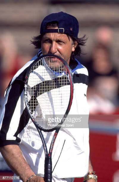 Veteran tennis player Ilie Nastase of Romania during a match at The Hurlingham Club in London England circa 1997