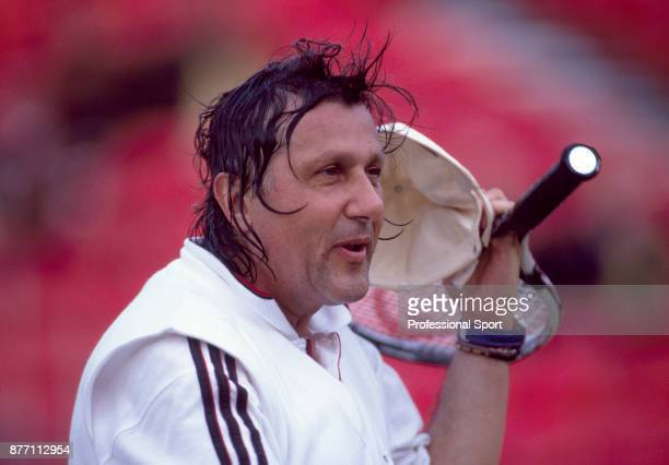 Veteran tennis player Ilie Nastase of Romania during the Stella Artois Championships at the Queen's Club in London England circa June 1998