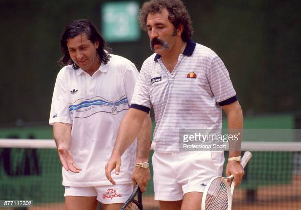 Veteran tennis players and doubles partners Ilie Nastase and Ion Tiriac both of Romania leave the court during the Italian Open Tennis Championships...